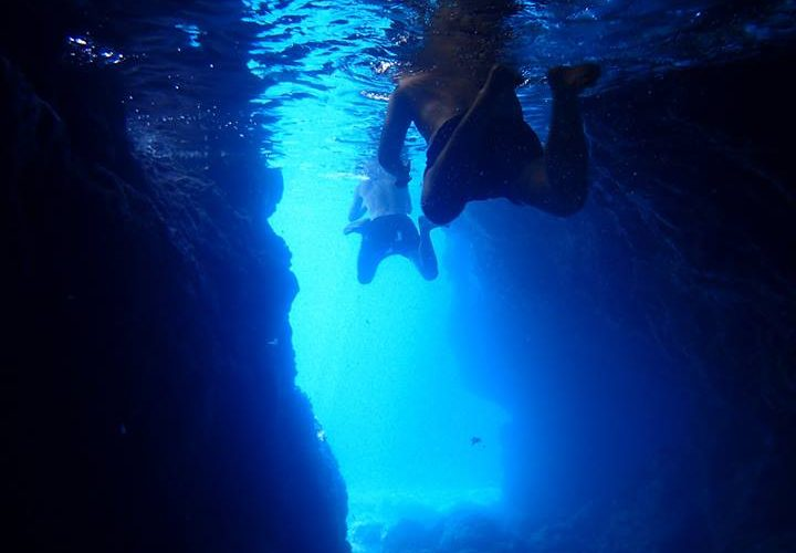 Swimming into a cave on island Vis - Magic island sea kayak tour Croatia