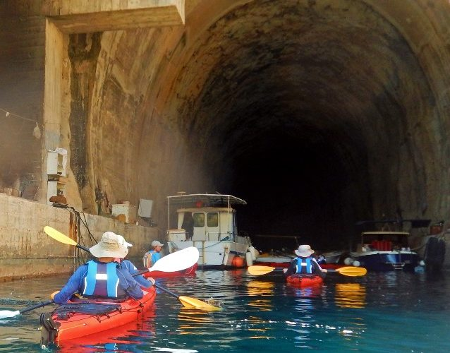 Exploring the navy tunnels with kayaks
